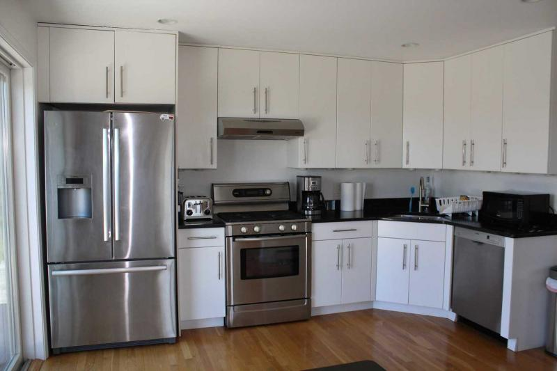 Kitchen with stainless appliances and slider