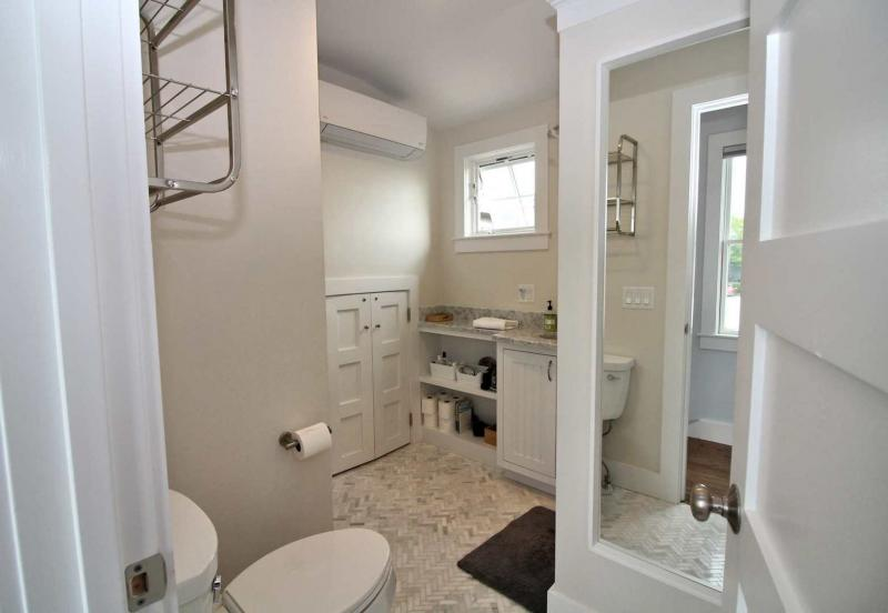 Large bathroom with shower and laundry