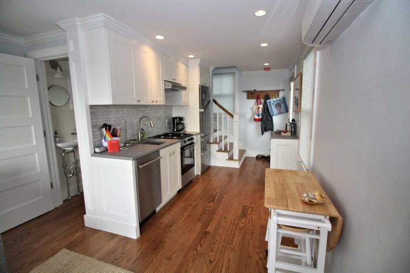 Spacious living and kitchen area with hardwood flooring