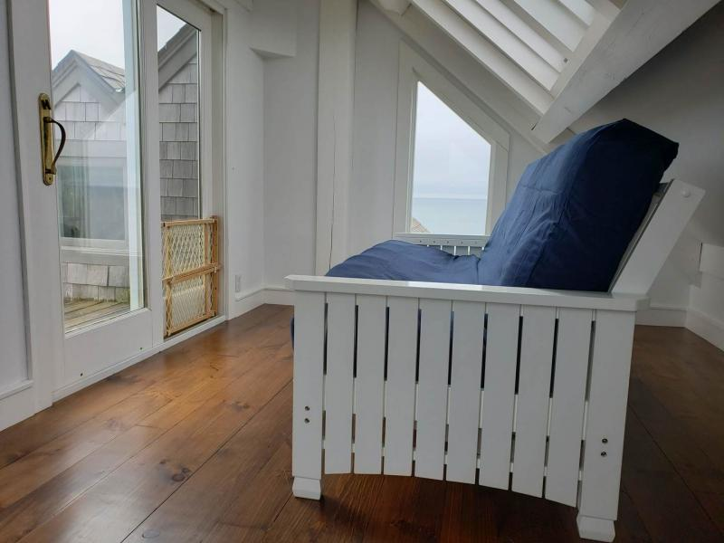 Third floor alcove with deck and futon sofa