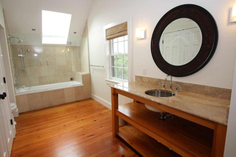 Guest cottage second floor master bath with tub and shower