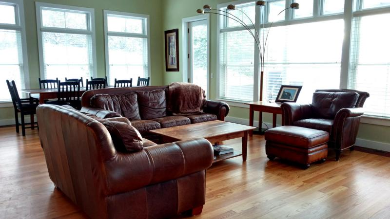 Living and dining area with door to deck