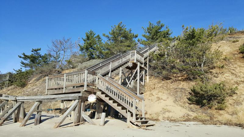 Beach stairs lead up to the property