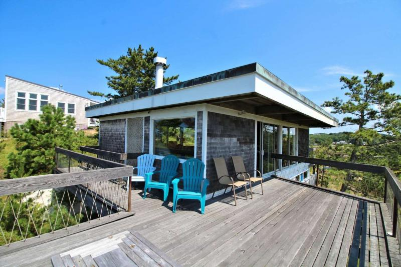 Large deck surrounds Mid Century beach house