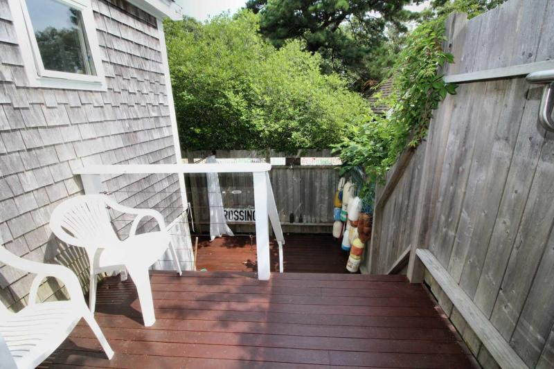 Deck with private outdoor shower below