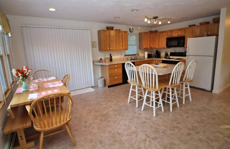 Dining area and kitchen with slider to deck