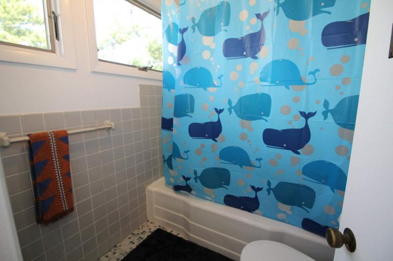Second floor full bathroom with tub and shower