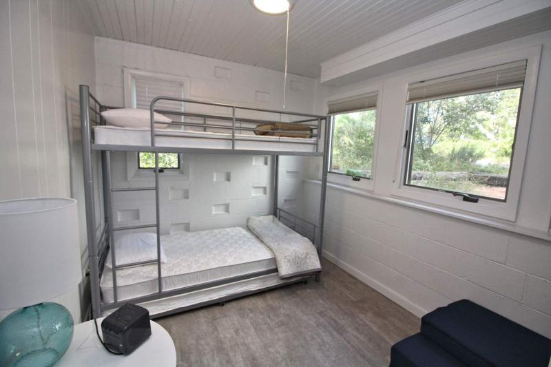 Lower level bedroom with bunk bed and trundle