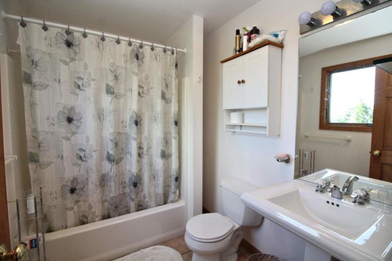 Second floor en suite bathroom with tub and shower