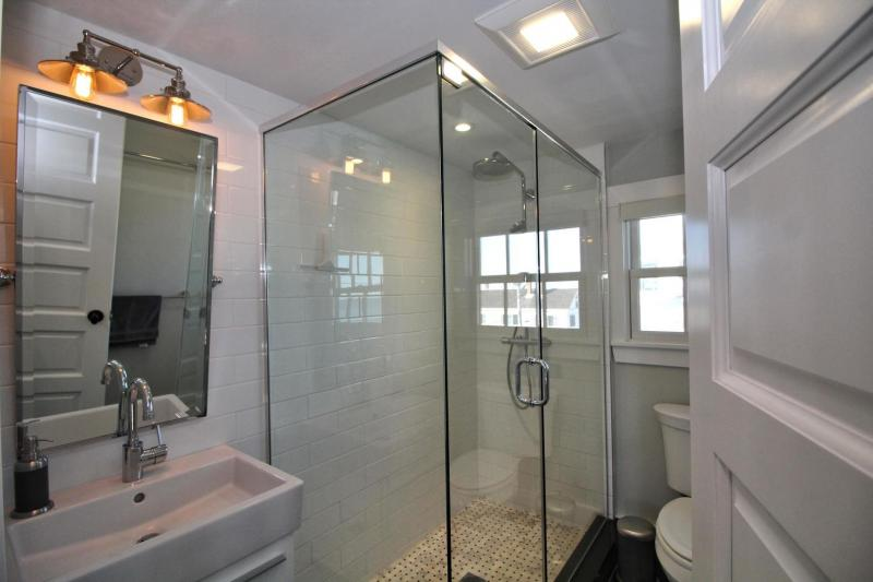 Full bathroom with glass and tile shower
