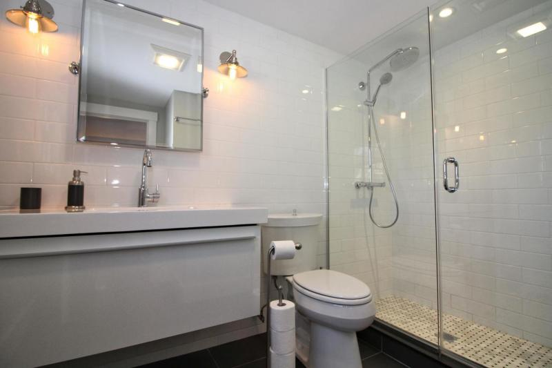 En suite bathroom with tile and glass shower
