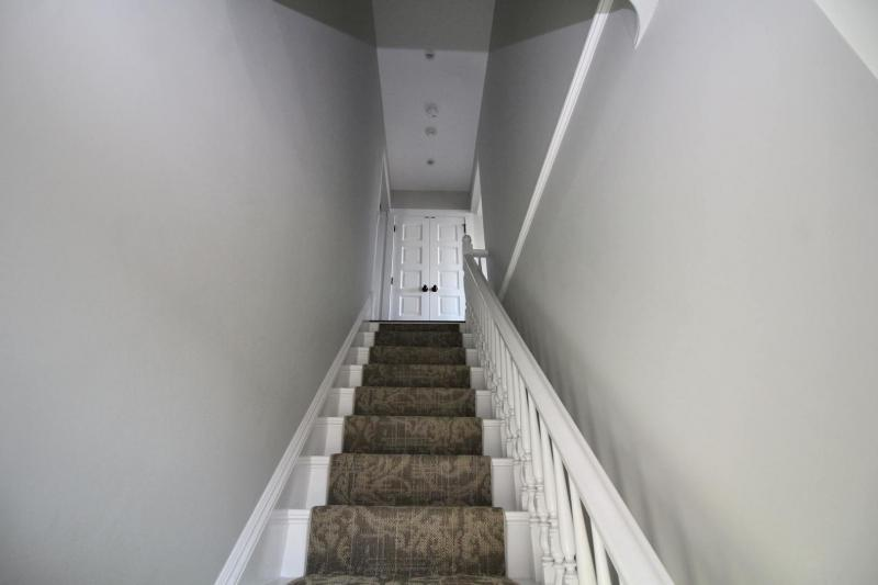 Staircase leads from foyer to unit