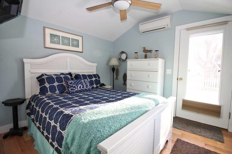 Comfy bedroom with door to fenced in yard