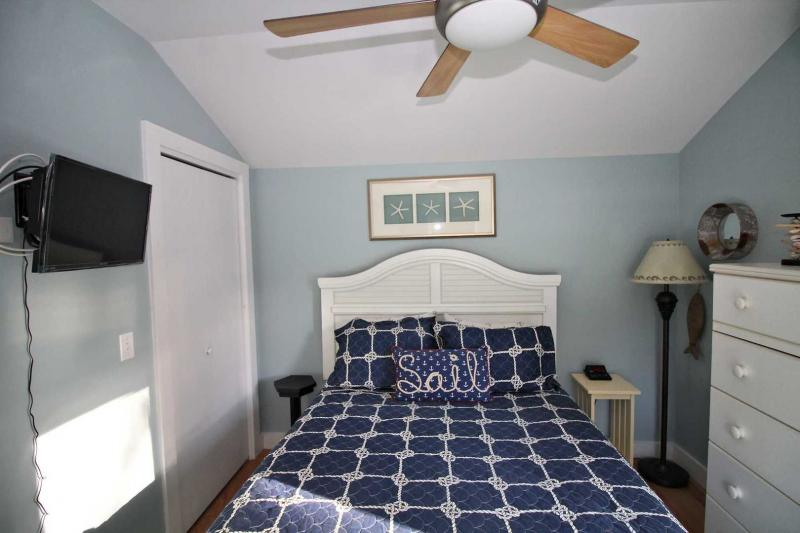 Bedroom has queen bed and ductless split unit AC