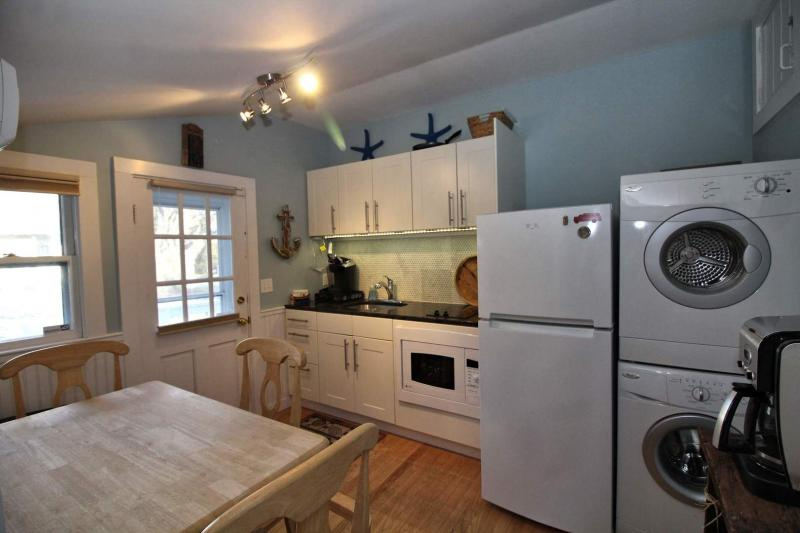 Kitchen has a washer and dryer