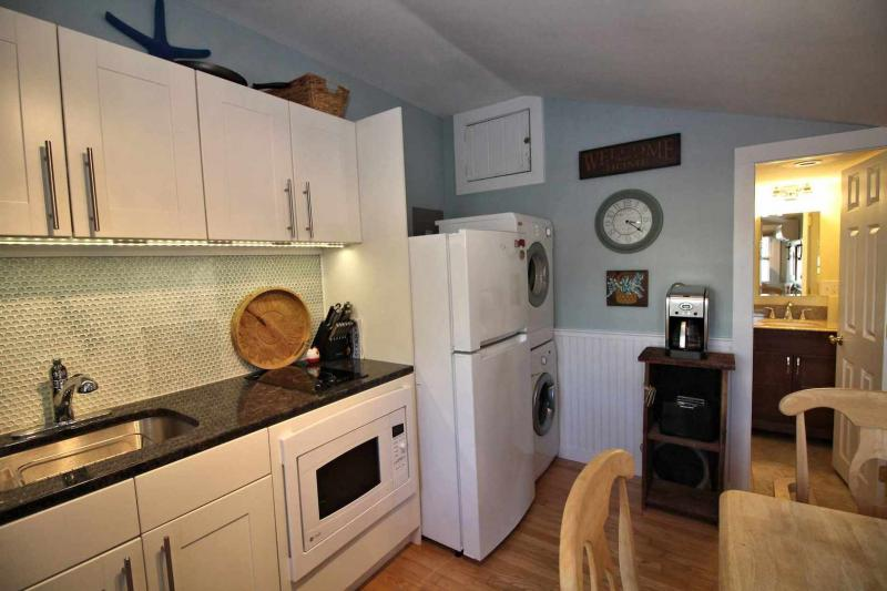 Bright kitchen with stove top and convection oven