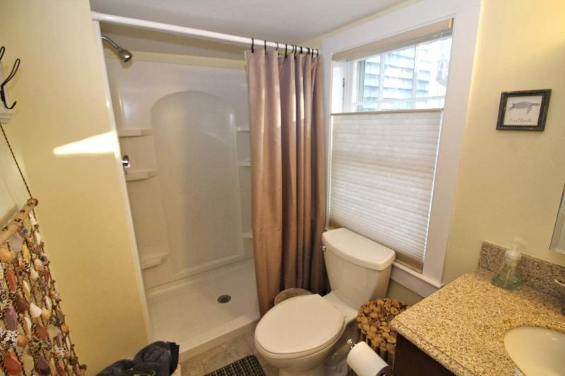 Nicely appointed bathroom has an oversized shower