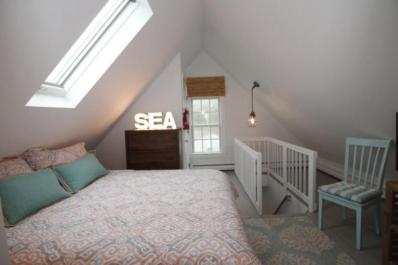 Third floor bedroom with queen