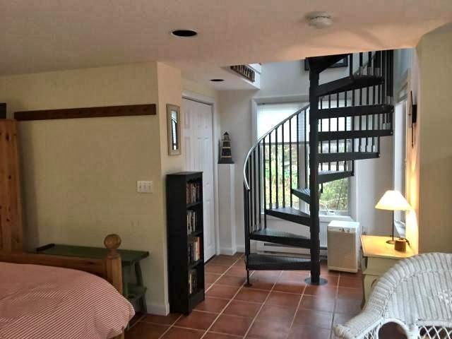 Lower level master bedroom has circular stairs to first floor
