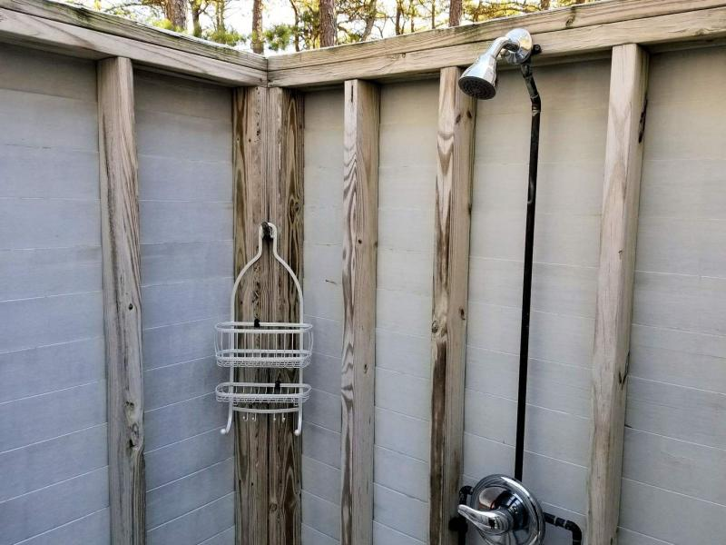 Enclosed outdoor shower off dining room