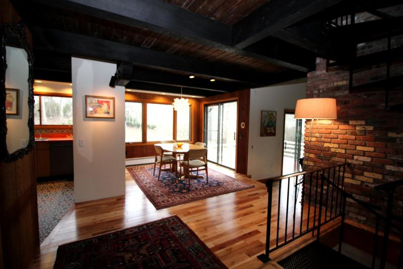 Harwood floors and exposed beam ceilings in foyer