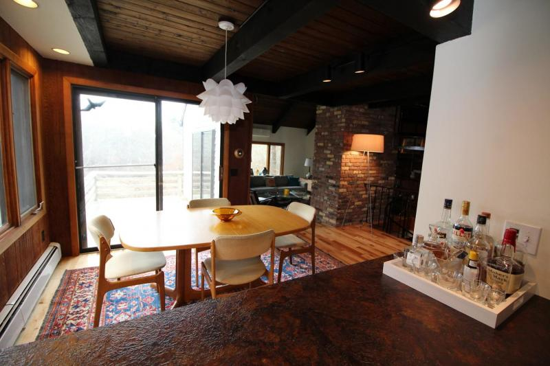 Kitchen is open to dining room and sliders beyond
