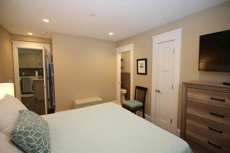 Master bedroom with queen and bathroom with shower
