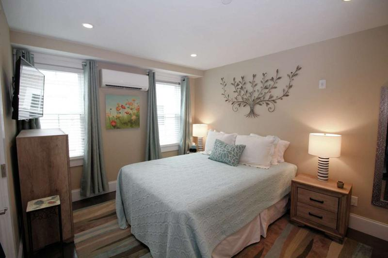 Master bedroom with queen and flat screen TV