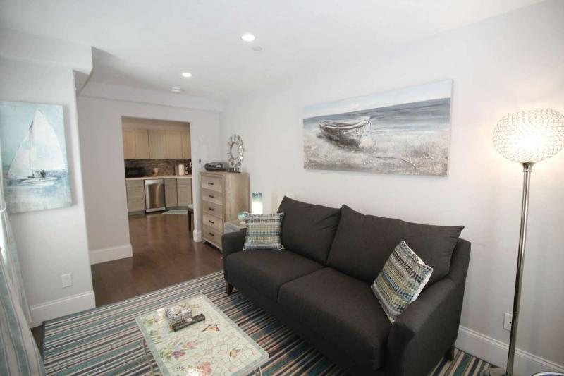 Comfortable living room with sofa and flat screen TV