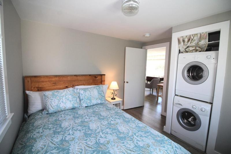 Master bedroom with queen and washer and dryer