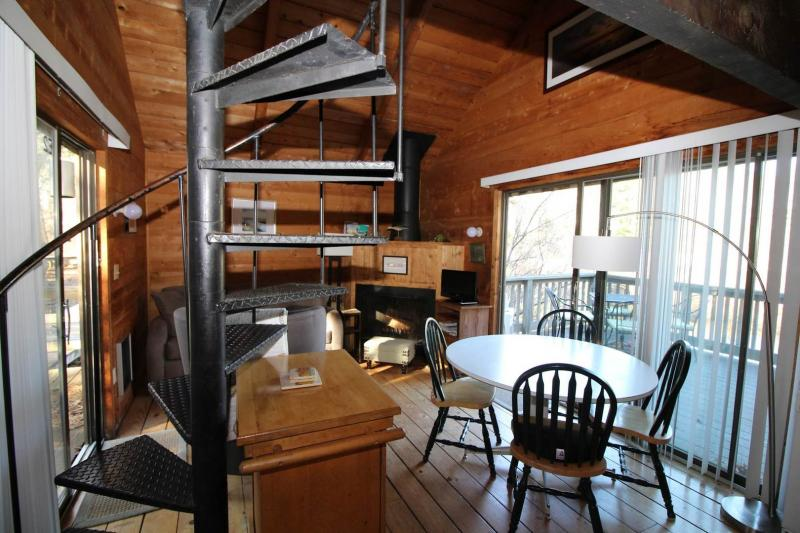 Spiral staircase leads to second floor loft