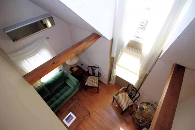 Looking down at living room from loft