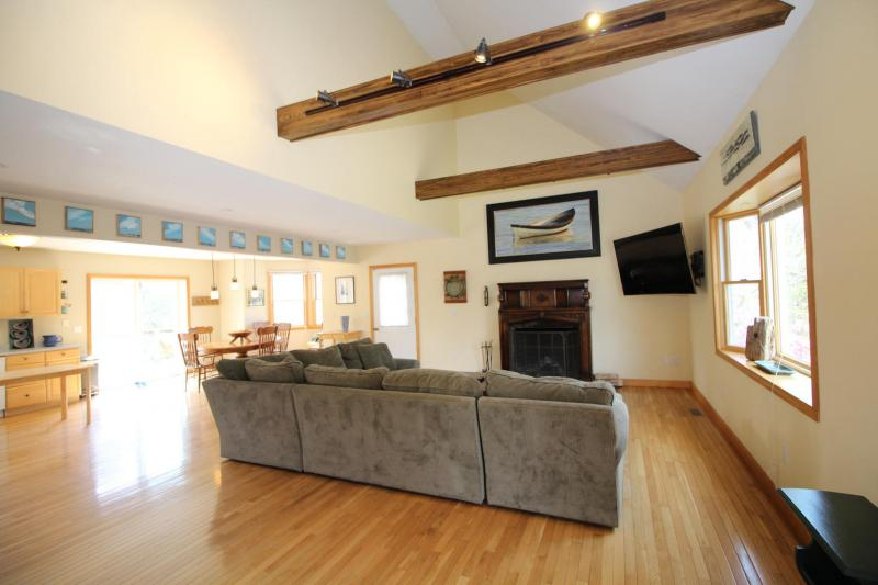 Living room with comfortable sectional and flat screen TV