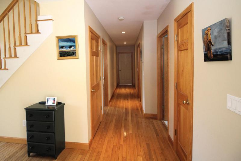 First floor hall leads to bedrooms and bathroom