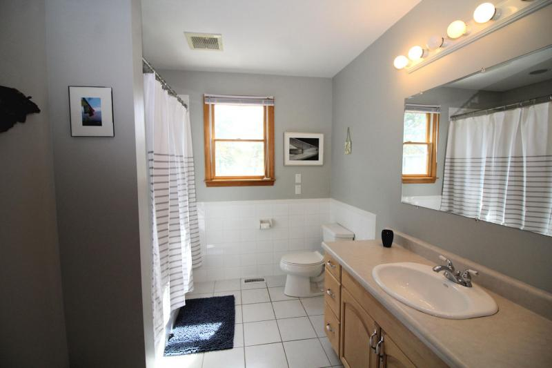 First floor bathroom with tub and shower