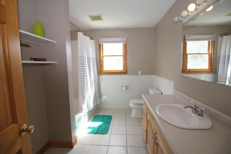 Second floor bathroom with tub and shower