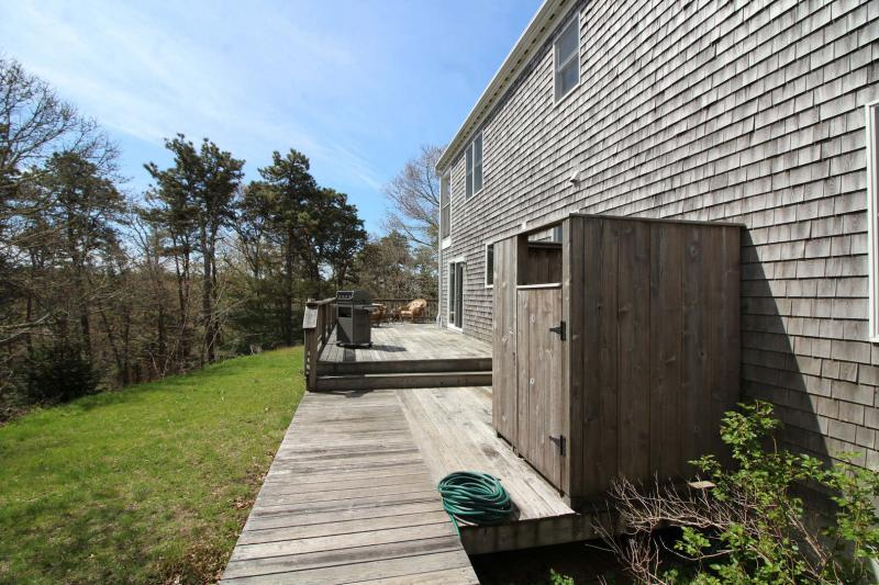 Large deck with gas grill and outdoor shower
