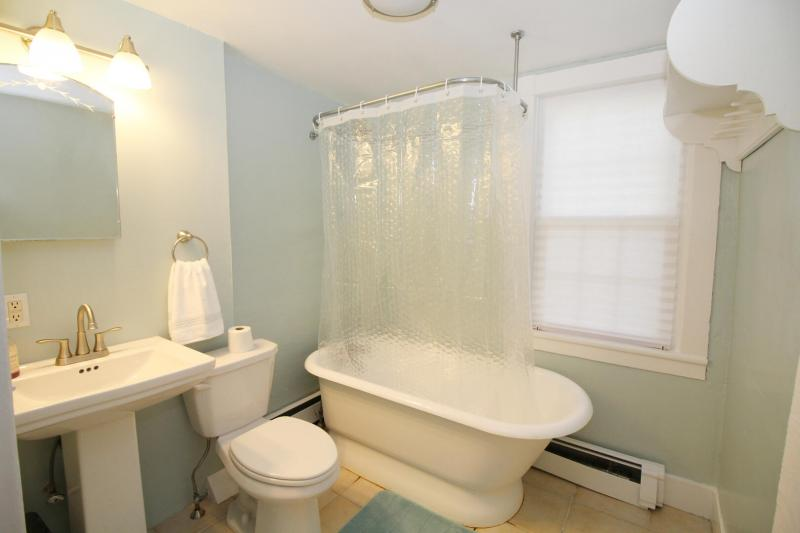 First floor bathroom with shower off dining room