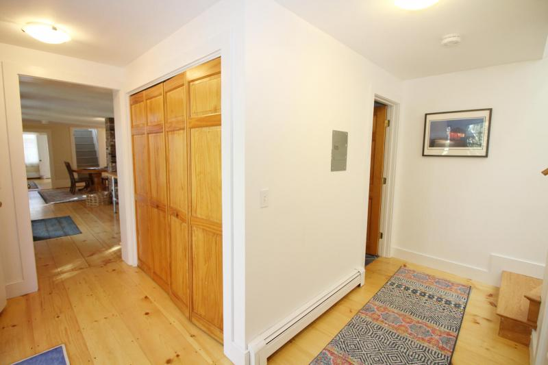 Hall with door to kitchen and stairs to master bedroom