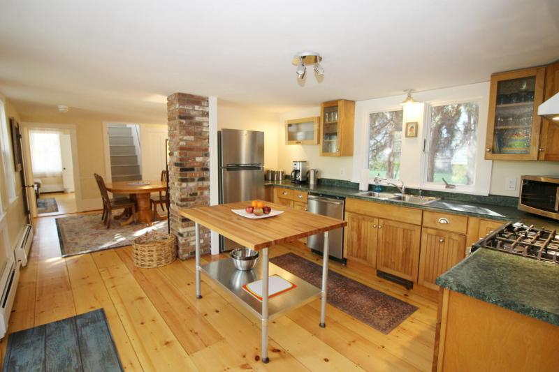 Nicely equipped kitchen opens to dining room
