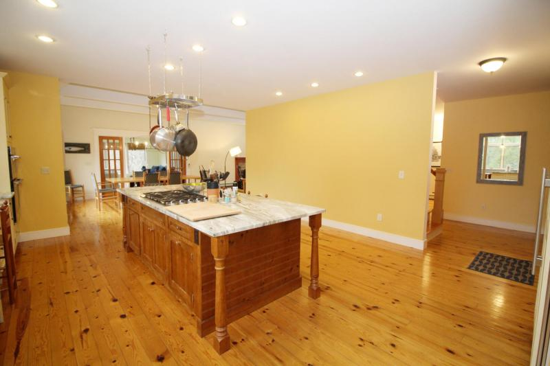Spacious kitchen with dining area beyond