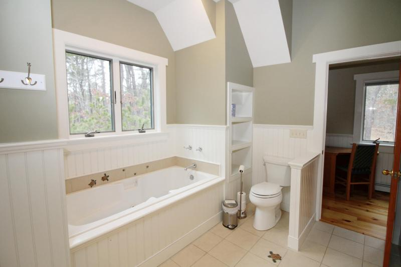 Second floor master bathroom with shower and jetted tub