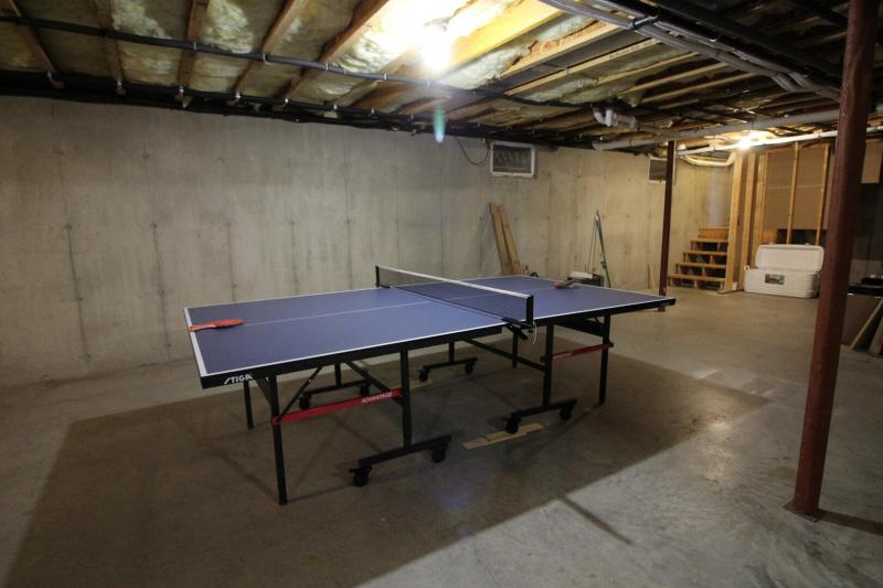 Ping pong table in the unfinished basement