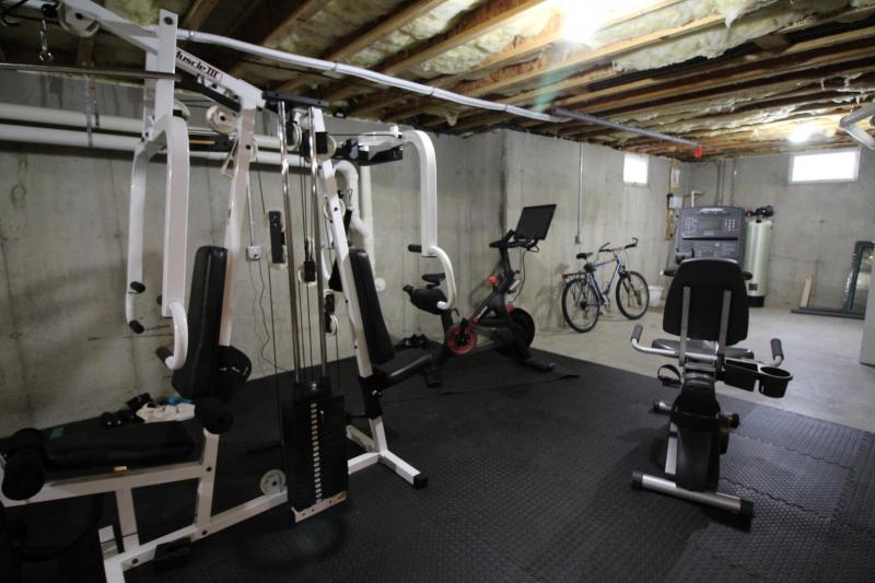 Workout equipment in the unfinished basement