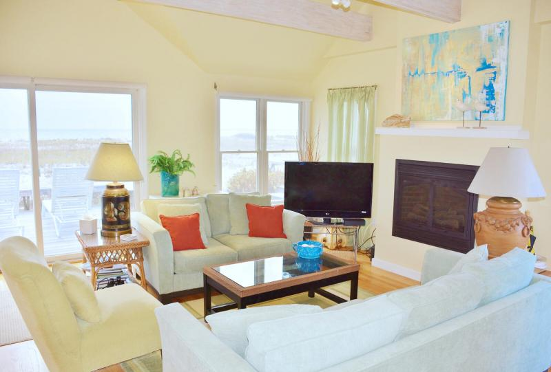 Living room has comfortable seating and a gas fireplace