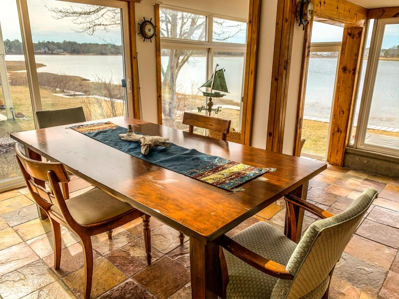 Gather around the table in the sunroom and enjoy the view