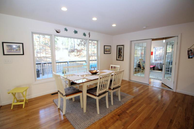 Dining area with sun room beyond