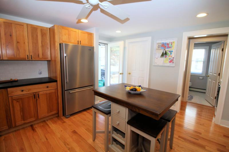 Kitchen has stainless appliances and custom counter tops