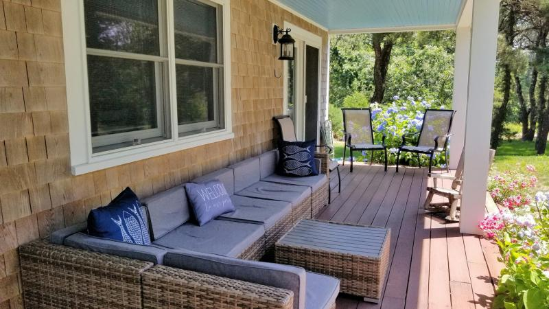 Lounge or dine on the front farmers porch