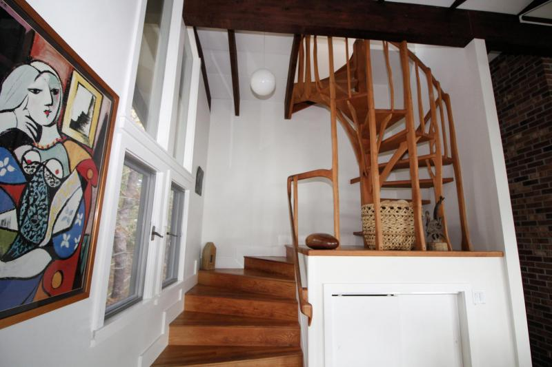 Custom staircase leads to second floor master